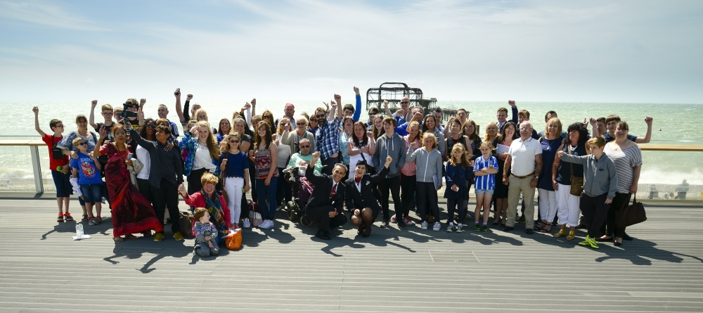 TDC youth workers and young community champions on Brighton promenade, in front of the West Pier