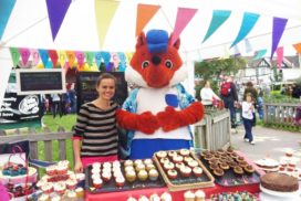 Giant fox and cupcake stand at Stoneham Park community event